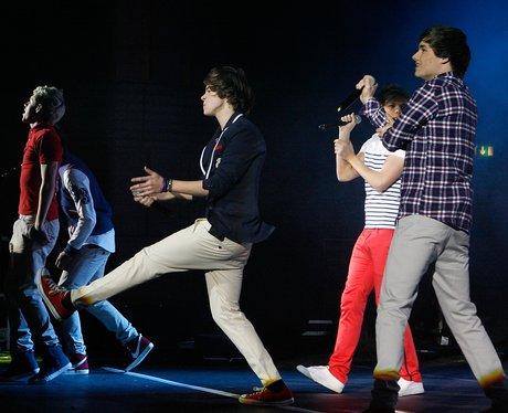 One Direction performing live in concert