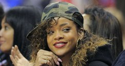 RIhanna watches basketball game