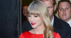 Taylor Swift wearing a red dress