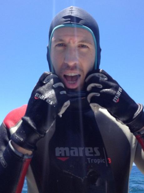 Calvin Harris wearing a wetsuit
