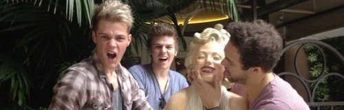 Lawson with a statue of marilyn monroe in America