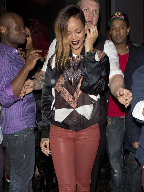 Rihanna wearing tight red trousers in Los Angeles