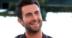 Adam Levine shows off his tattoos
