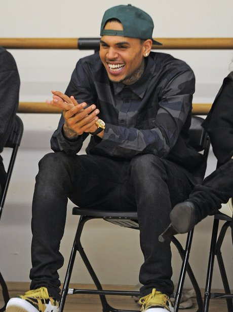 Chris Brown laughs during a visit to meet with students