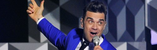 Robbie Williams live on stage at the BRIT Awards 2
