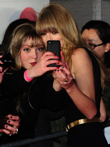 Taylor Swift and fans at the BRIT Award 2013