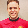 olly murs wearing a football shirt