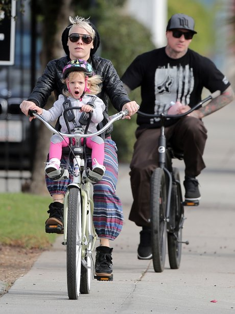 Pink and Willow riding a bike