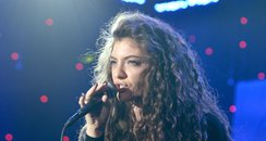 Lorde performing on stage