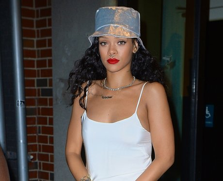 Rihanna shows off her new piercing.