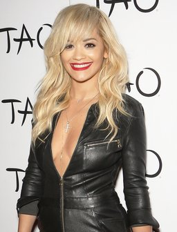 Rita Ora wearing a black catsuit
