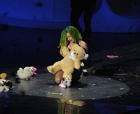 Lady Gaga performs with a teddy on stage