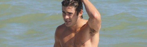 Zac Efron topless on the beach on holiday