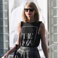 Taylor wears t shirt