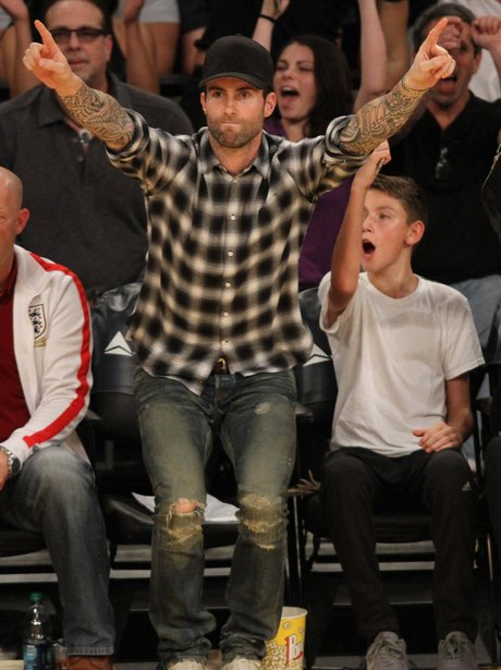 Adam Levine watching ther basketball