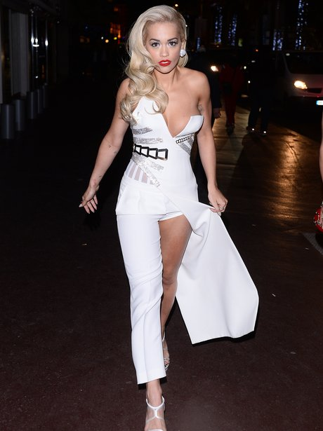 Rita Ora wearing a white jumpsuit