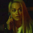 Rita Ora with phone in hand