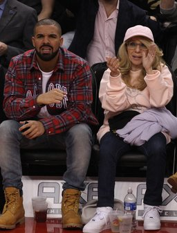 Drake and his mum watching basketball