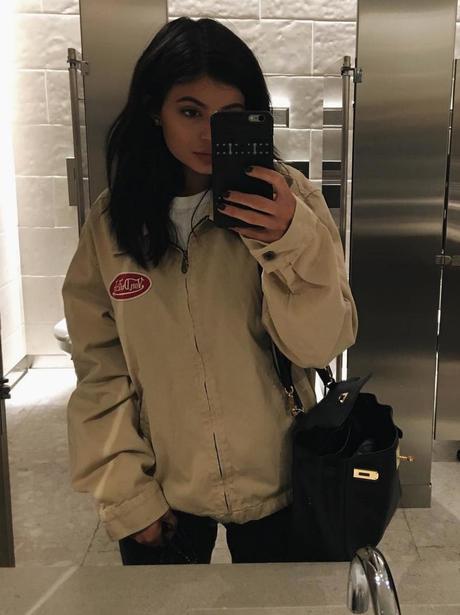 Kylie Jenner poses in Von Dutch jacket