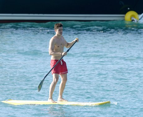 Orlando Bloom goes paddleboarding... with shorts on this ... Orlando Bloom Paddle Boarding